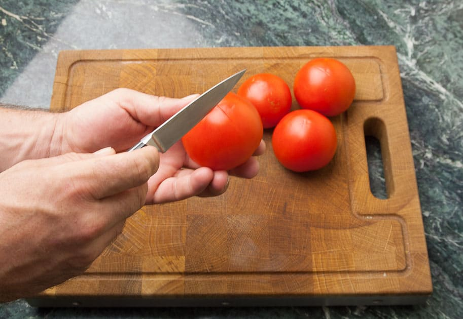 prepare the tomatoes for blanching: tomato-cross-shaped-skin incision