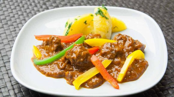 German pork goulash with peppers and potatoes