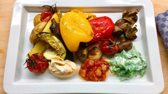 Delicious oven vegetables arranged on the plate