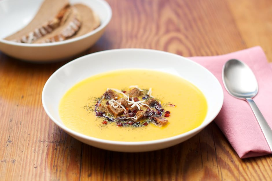 Styrian pumpkin soup with pumpkin seed oil, bread cubes, bacon and horseradish © thomas sixt bavarian chef and german food artist and food photographer