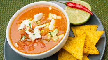 Cold tomato soup with sheep cheese, tomato cubes, avocado, lime and chilli. Refreshing and exciting in taste!