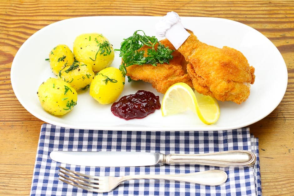 Original Chciken Nuggets on the plate with side dishes.