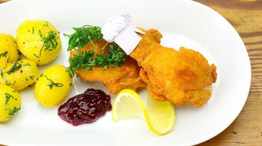 Baked chicken with side dishes aka original Bavarian chicken nuggets.