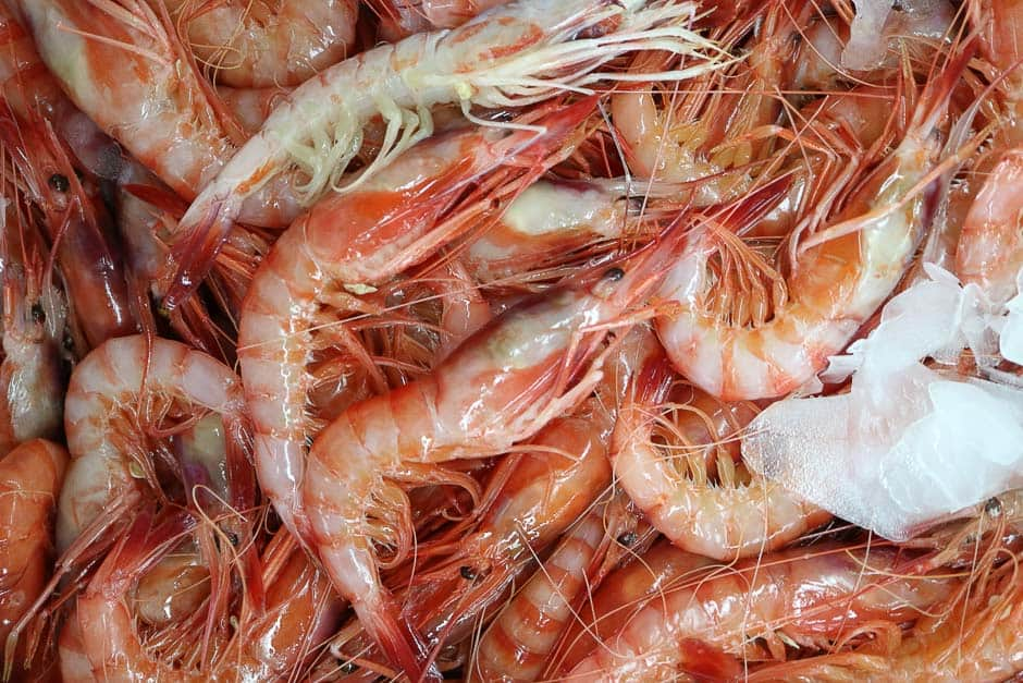 Preparing seafood, prawns in the picture at the market