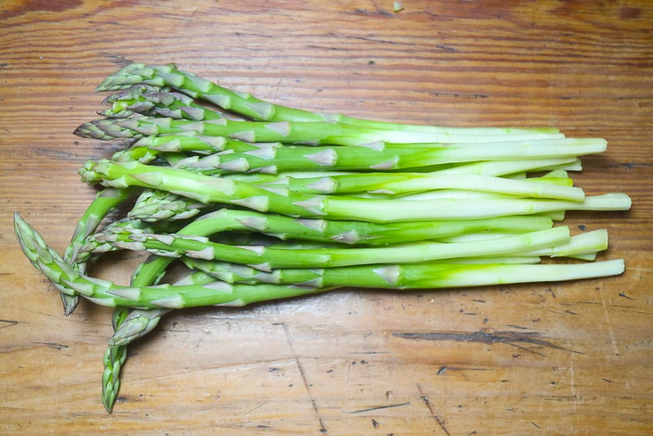Peeled green asparagus on the kitchen table
