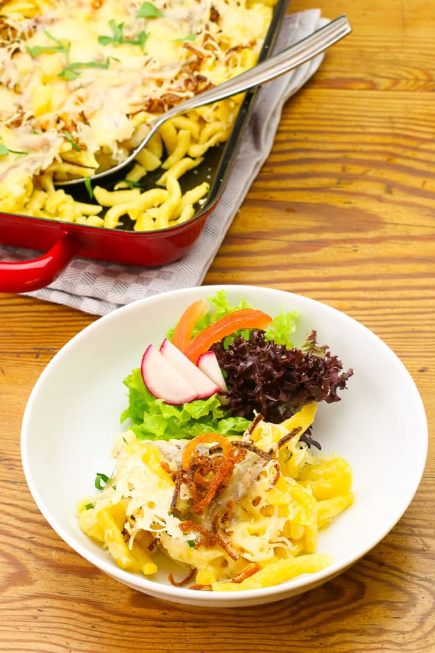 Cheese spaetzle served with salad.