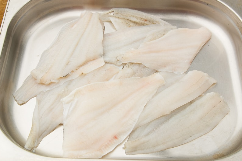 Fish fillets raw after thawing.
