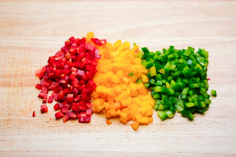 Diced vegetables on a board.