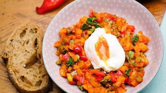 Lost eggs with ratatouille vegetables.