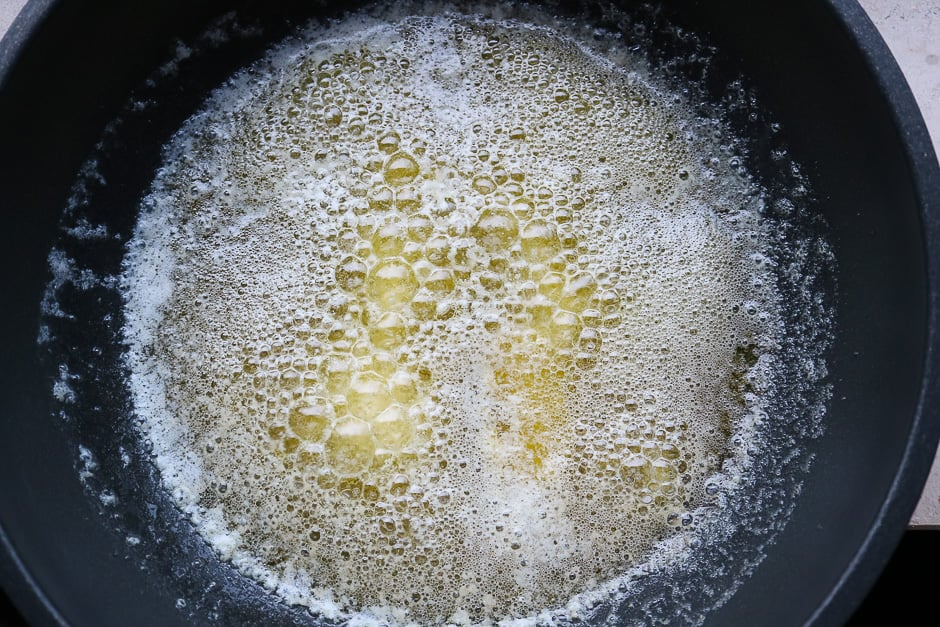 Butter in a saucepan while cooking.