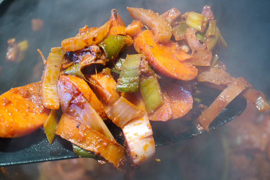 Roasted vegetables when frying with tomato paste.