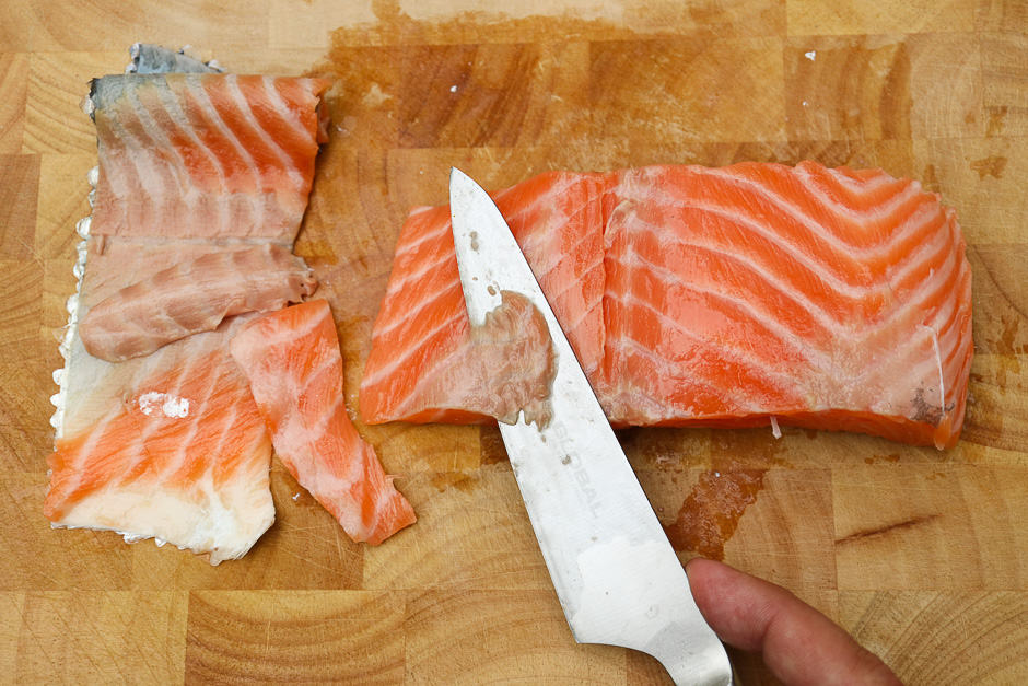 Clean the skinned salmon fillet.