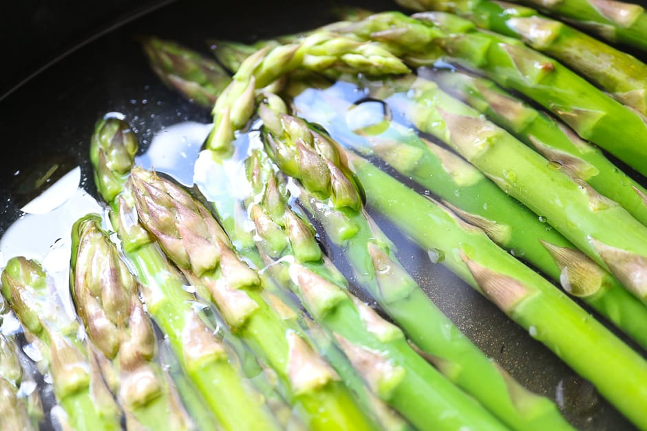 Founder asparagus cooking in the pot