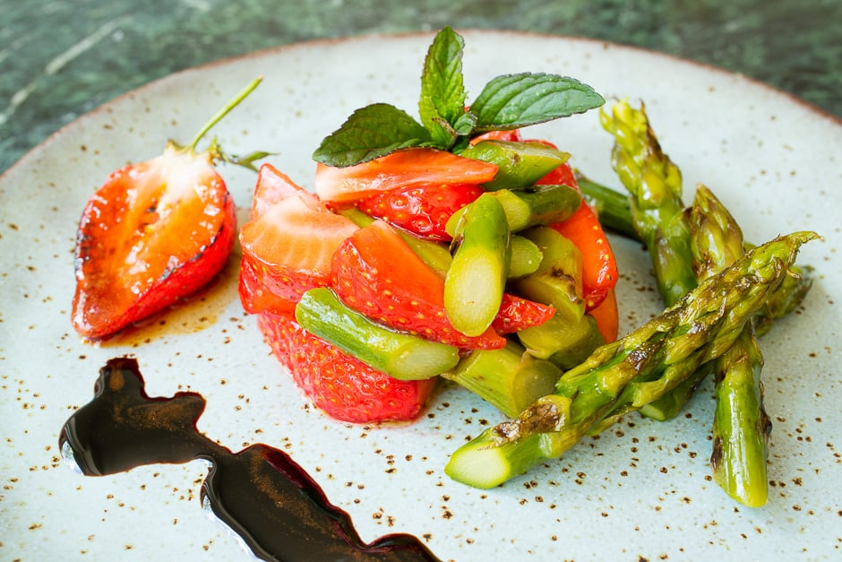 Asparagus salad with strawberries close-up.