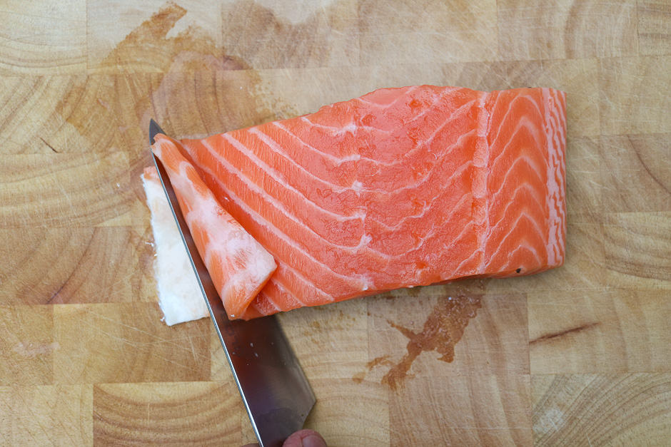 Fold up the belly flap of the salmon fillet