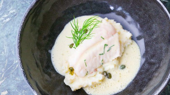 Fish with mustard sauce. Rose fish, Ocean Perch poached on mashed potatoes with capers and dill.