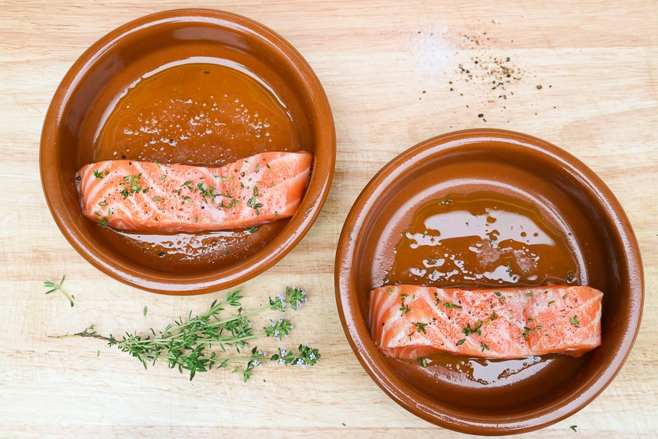 Salmon fillets in ovenproof forms when seasoning