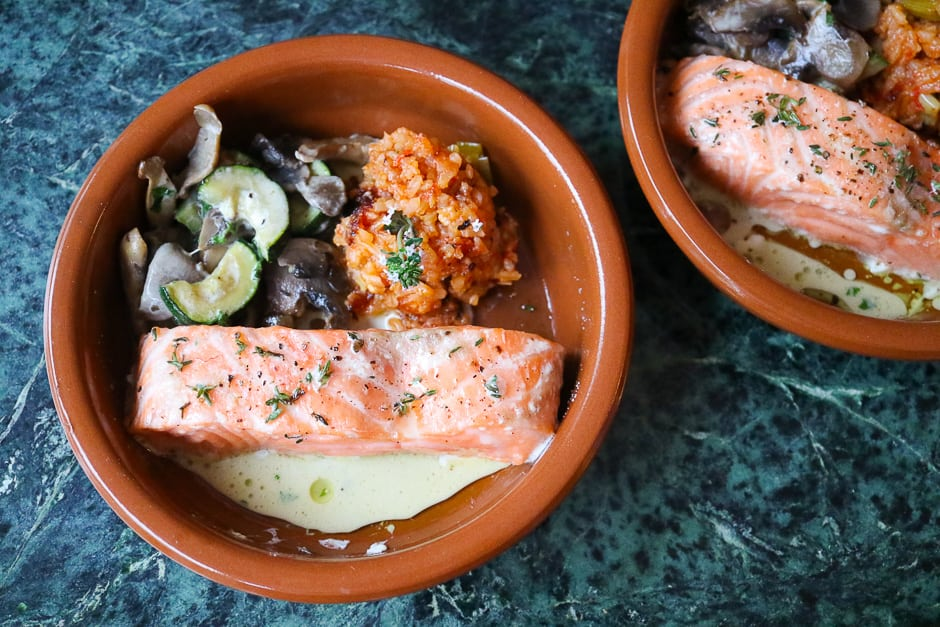 Salmon from the oven, served with a side dish of courgette, mushroom vegetables and tomato rice.