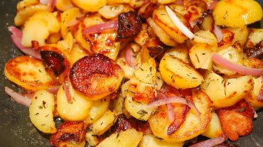 Classic fried potatoes in the pan with onions.