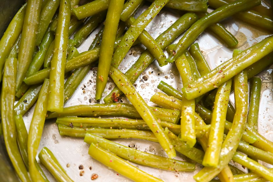Blanched beans in a saucepan with butter