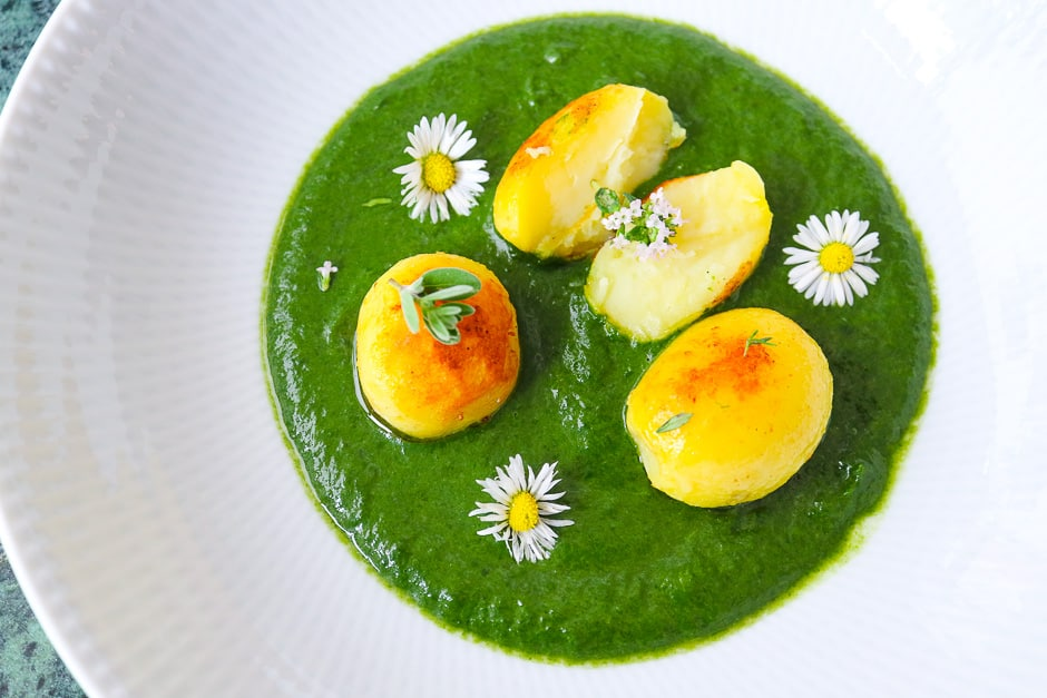 Leaf spinach dressed as creamed spinach with potatoes and herbs.