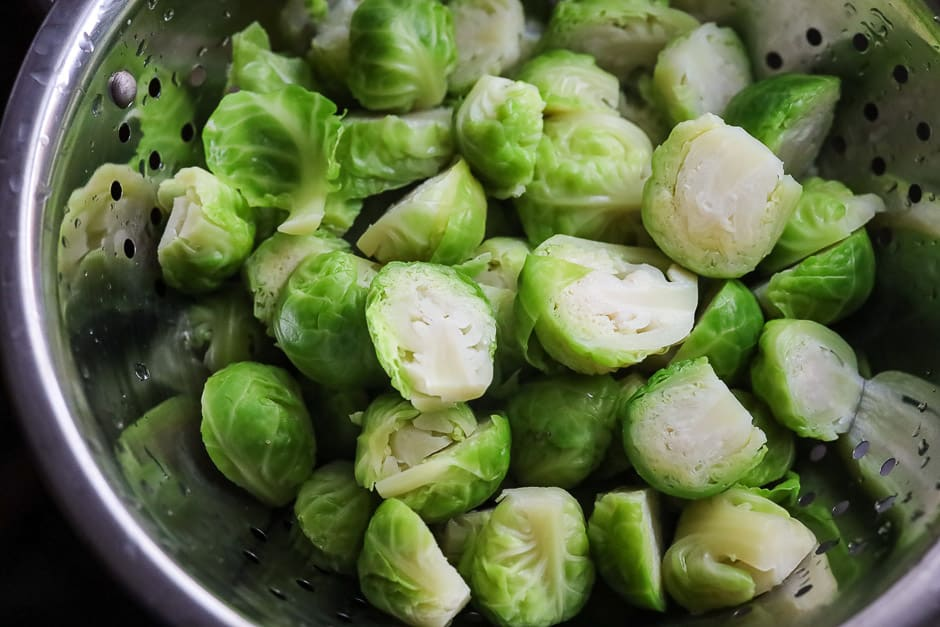 Blanch the Brussels sprouts