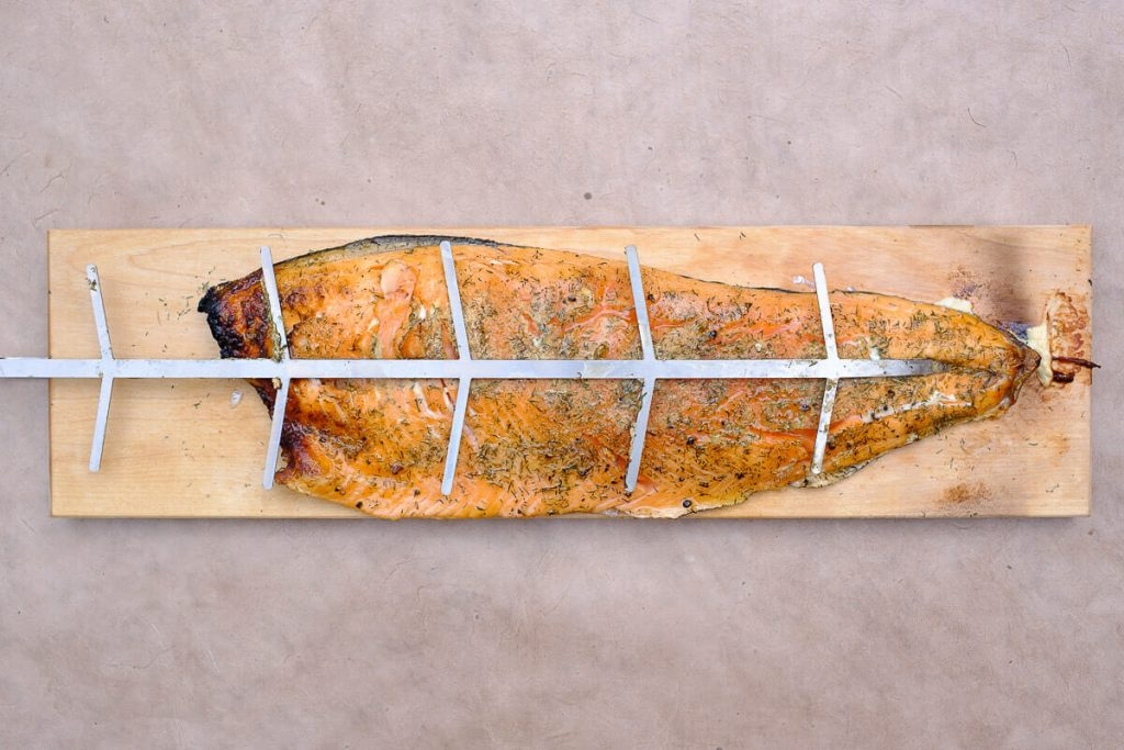 Flamed salmon cooked on a board