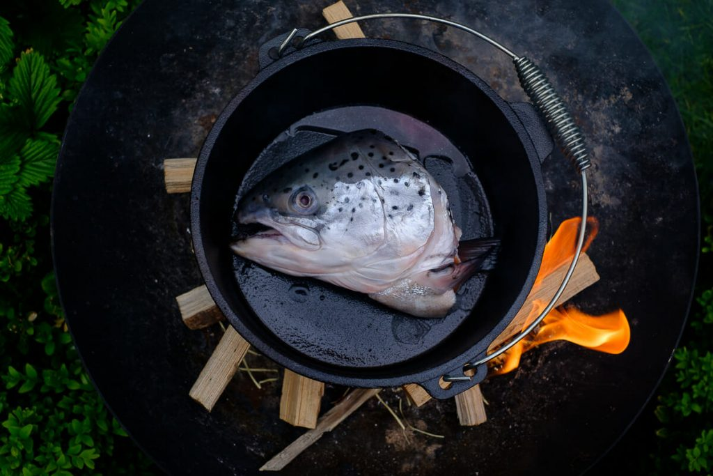 Light a fire Cooking fish soup