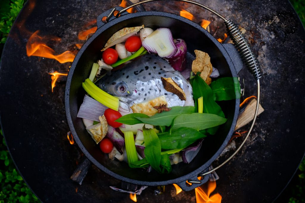 Fish soup ingredients in the pot