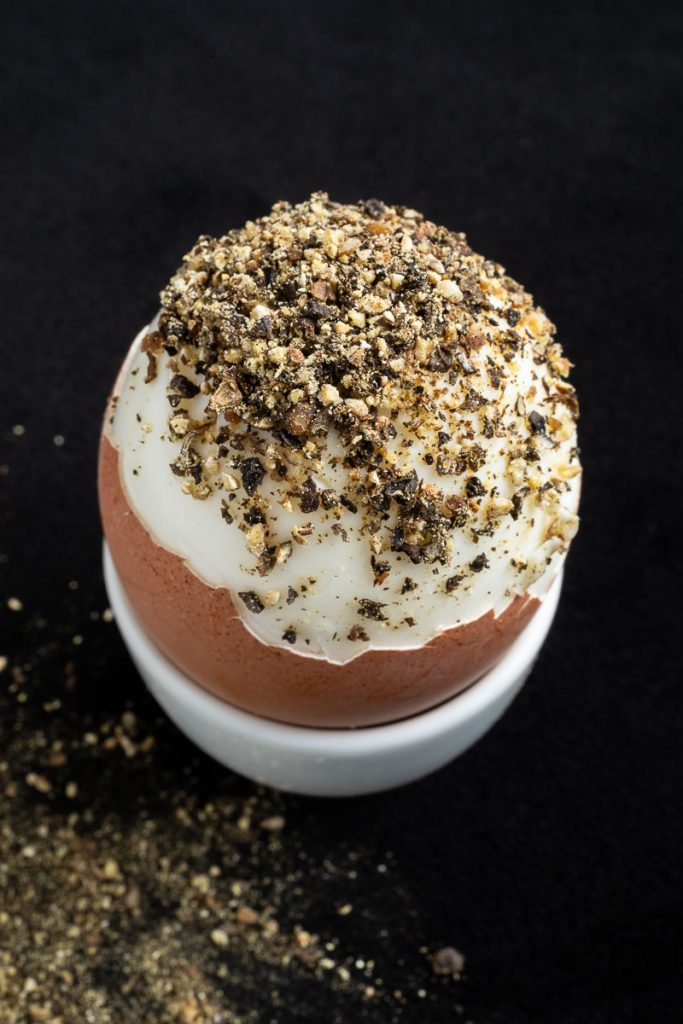 Soft boiled egg with pepper