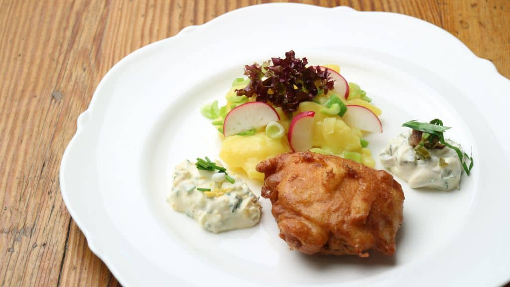 baked carp with potato salad. the bavarian classic in the christmas kitchen as christmas carp
