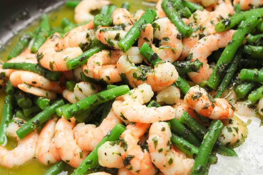 Shrimps and beans in salad marinade, delicious and shining with flavour.