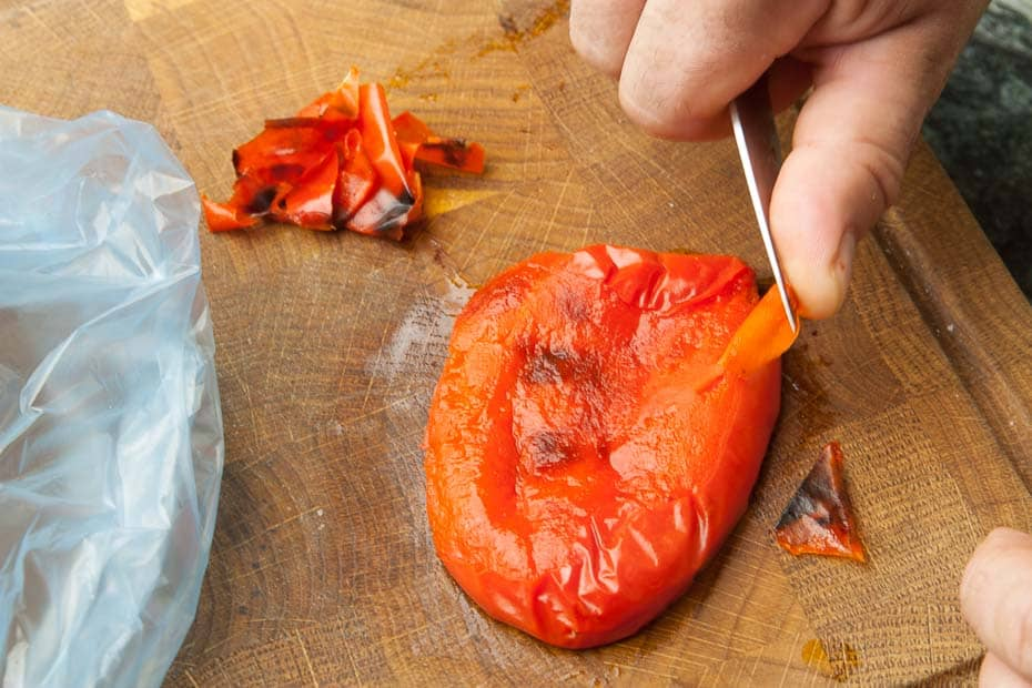 Peel off the grilled pepper.
