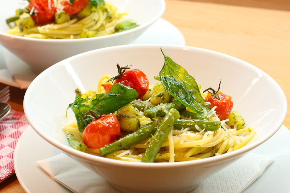 pasta-pesto-genovese with crunchy herbs and caramelized tomato