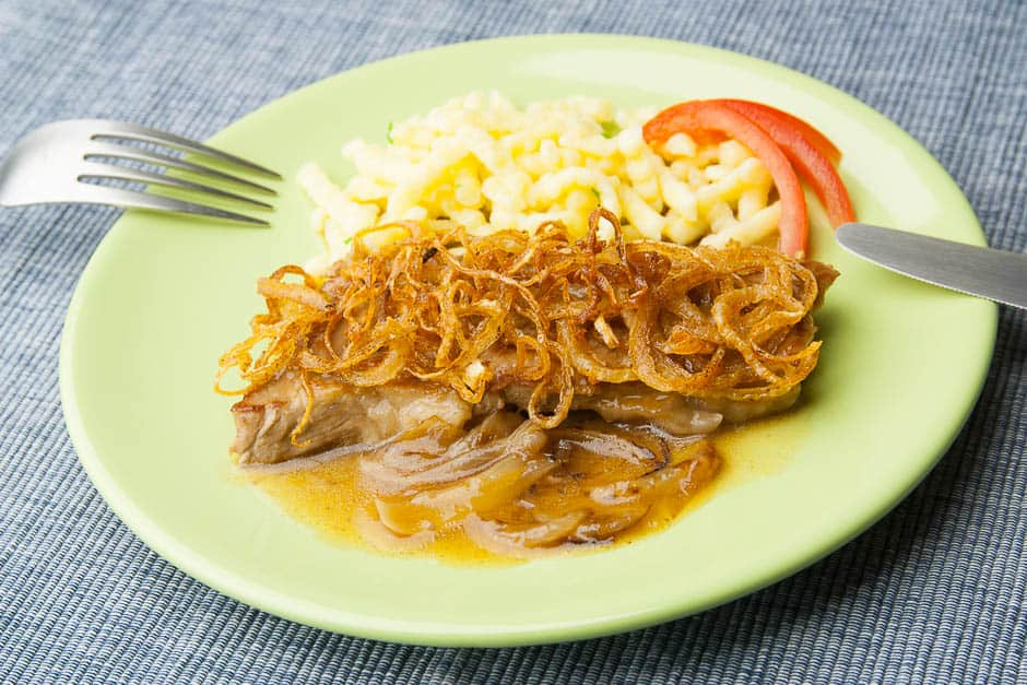 German Roast Beef Steak with Onion Gravy and spaetzle named Zwiebelrostbraten
