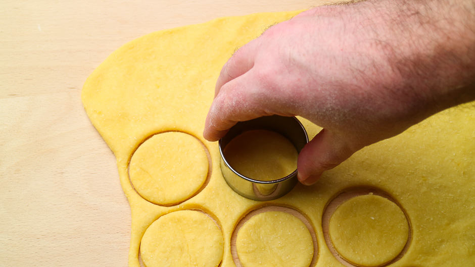 Yeast dough for doughnuts when cutting out.