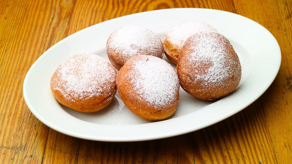Homemade doughnuts, doughnuts, carnival doughnuts.