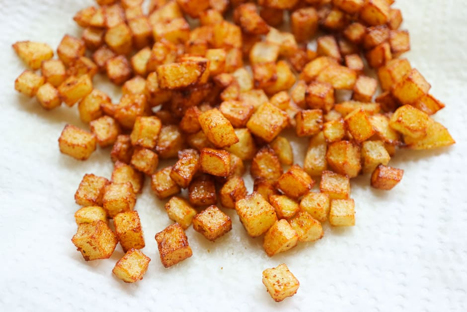 Potato cubes fried close-up view