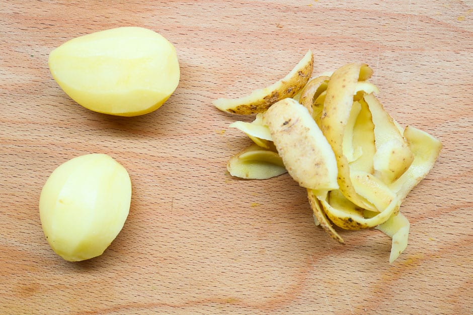 Peeled potatoes for the preparation of homemade potato cheese.