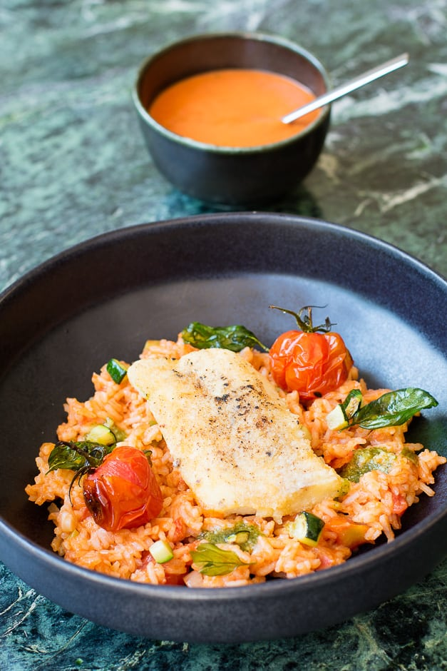 Fish fillet fried, served on tomato rice.