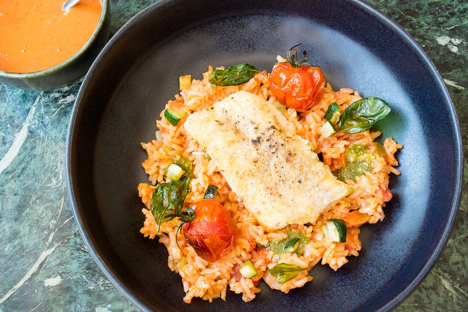 Cod fried in a pan served on Mediterranean rice.