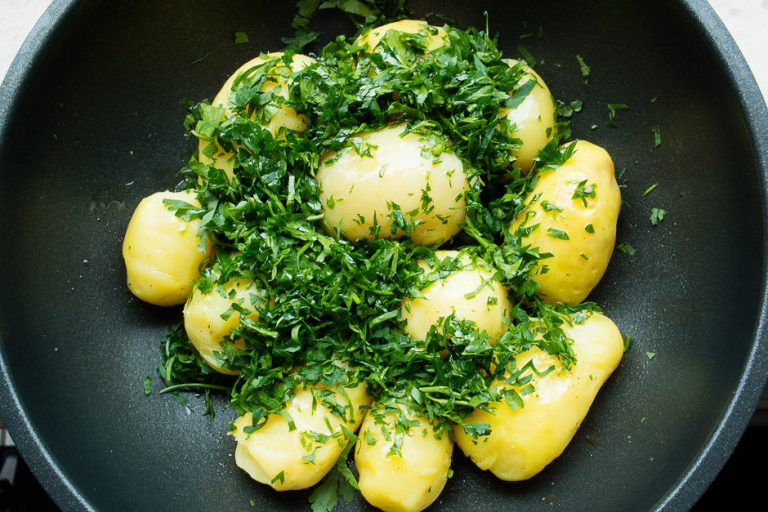 Potatoes in a pan with parsley.