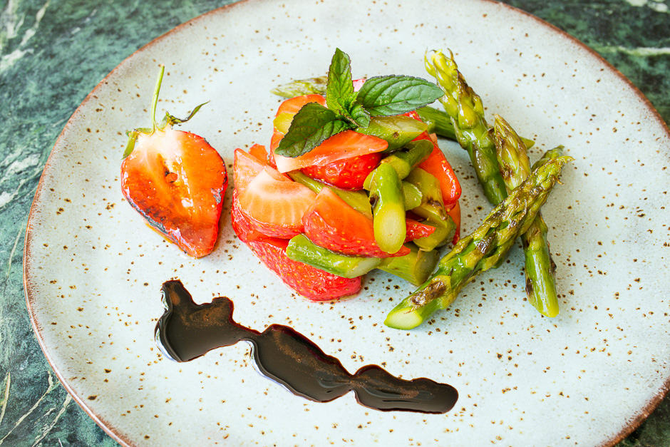 Asparagus salad with strawberries served with balsamic ice cream, which is boiled down and greatly reduced balsamic vinegar.