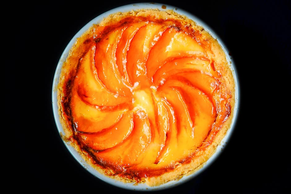 Apricot cake on a black background.