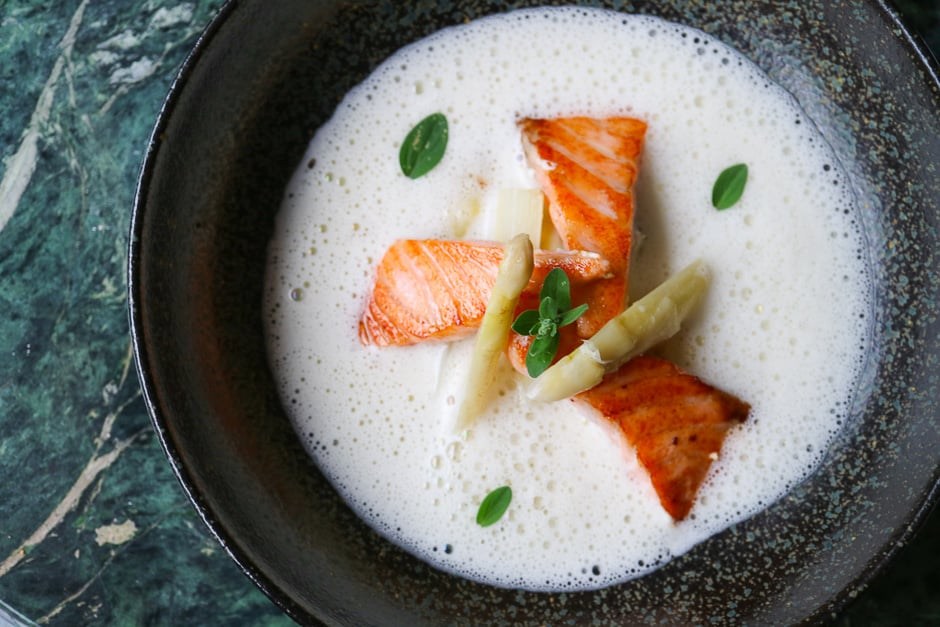 Asparagus cream soup with salmon
