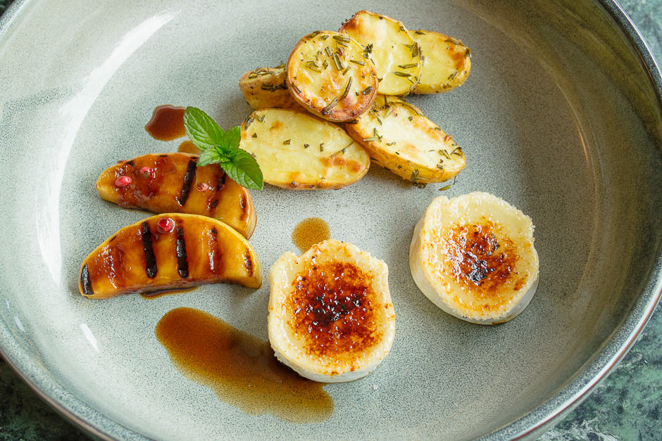 Goat cheese with baked potatoes and glazed apple slices