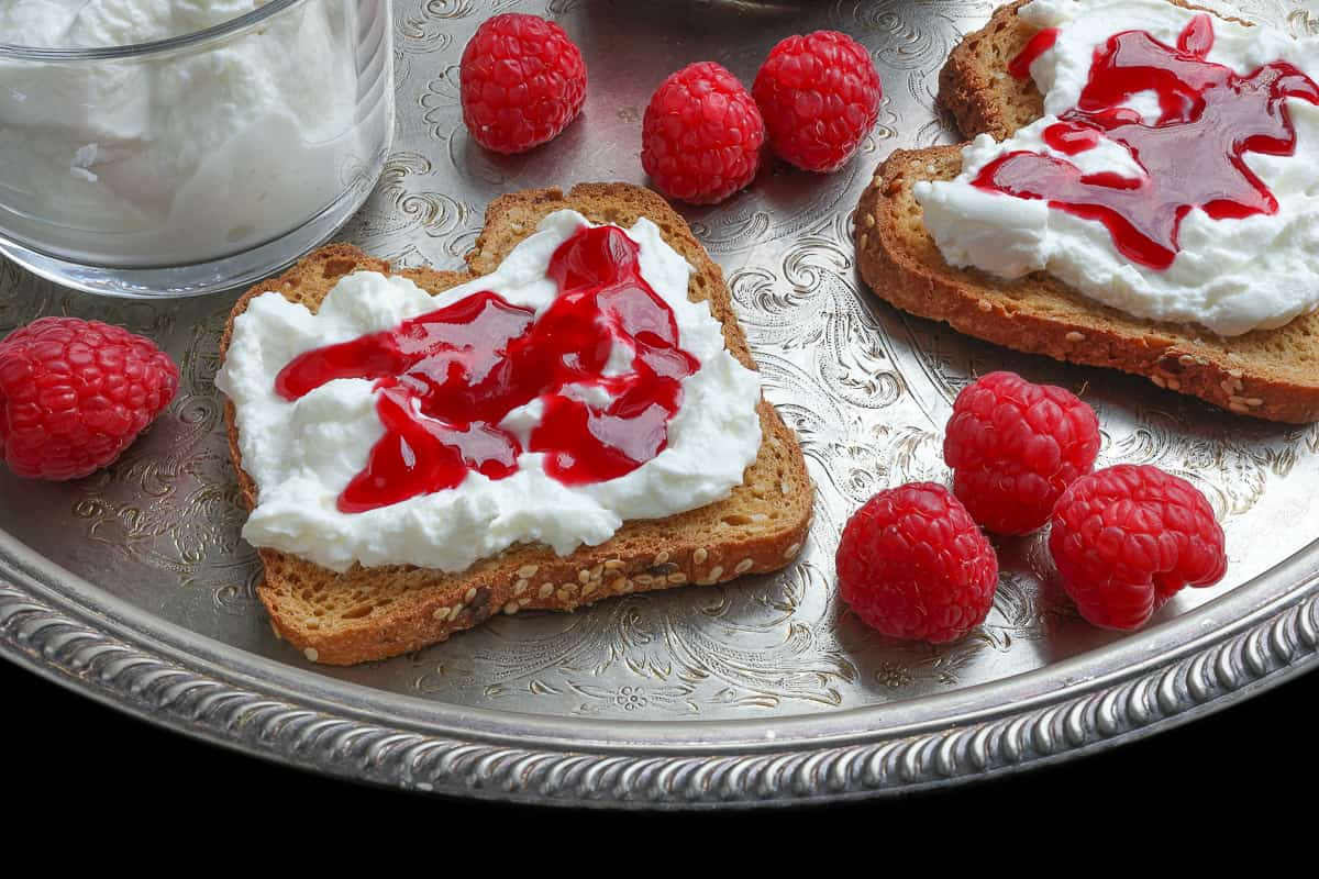 Raspberry jam on bread with curd